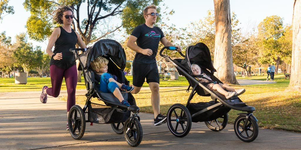 couple running with children in BOB strollers