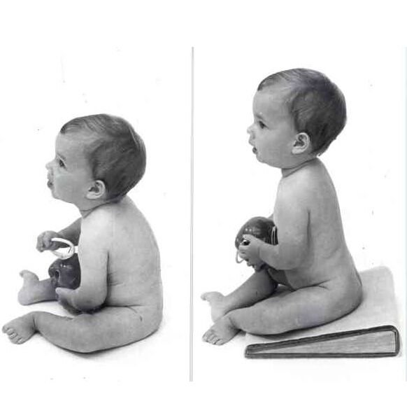 comparison of baby sitting on floor and using sitting wedge.
