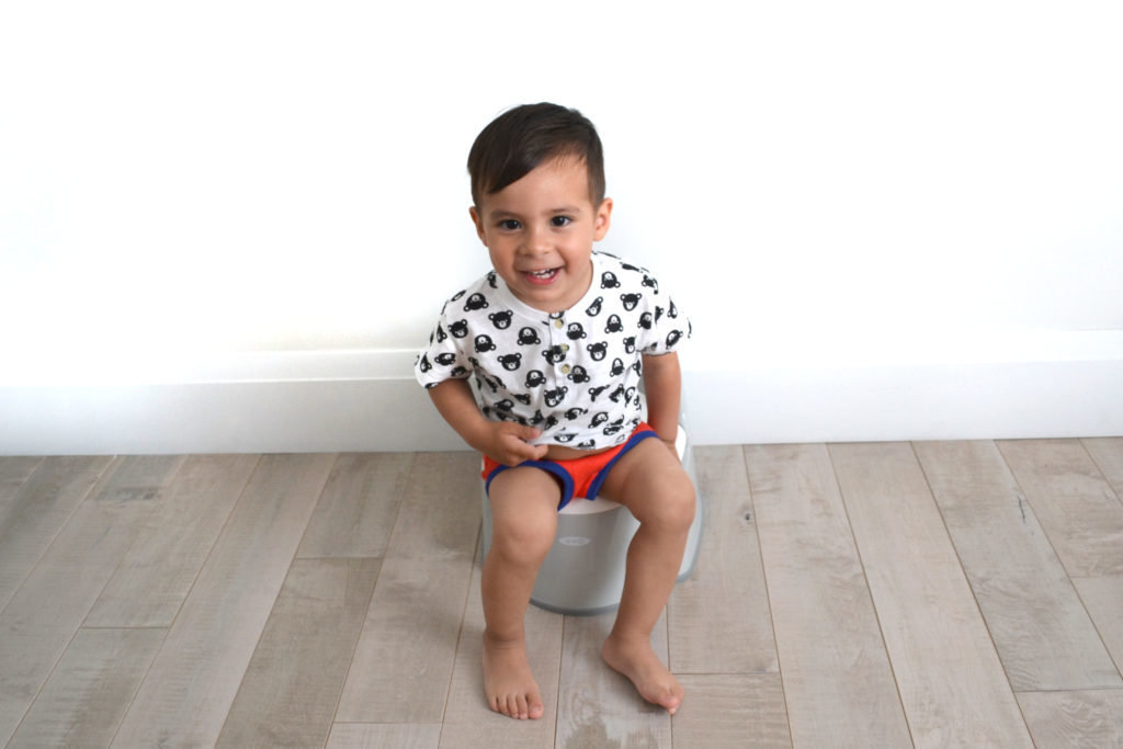 Boy sitting on OXO Tot Potty Chair in Grey