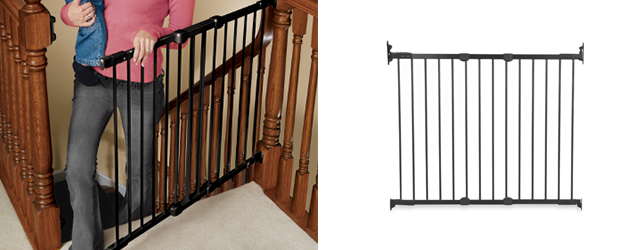 Safety baby gates from Kidco installed at the top of stairs.