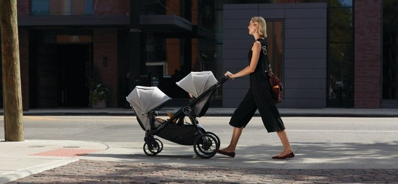 Woman pushing Baby Jogger City Select Stroller with second seat option