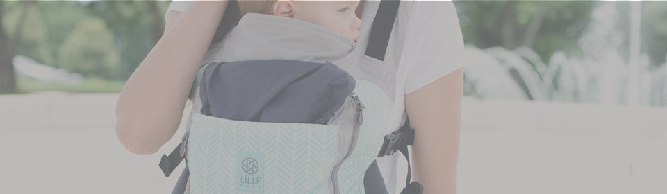 LILLEbaby  baby carrier with baby on mother