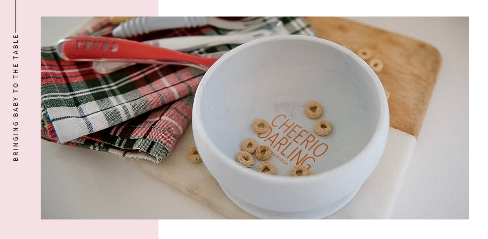 Bella Tunno Cheerio Darling Baby Bowl on Wooden Cutting Board with Plaid Napkin