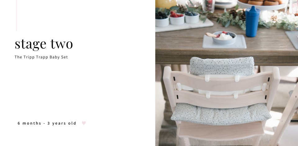 back view of Stokke Tripp Trapp baby set highchair at table
