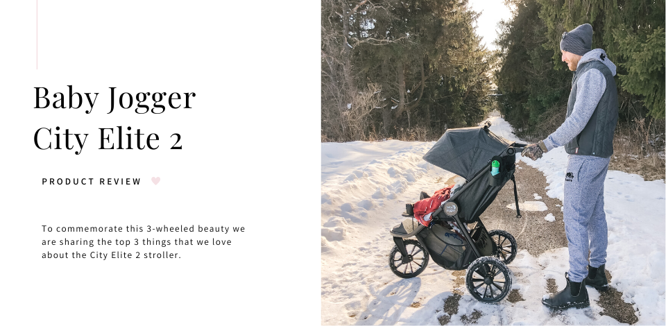 dad pushing son in a Baby Jogger City Elite 2 stroller in the snow