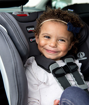 Little girl sitting in a Britax Boulevard convertible car seat
