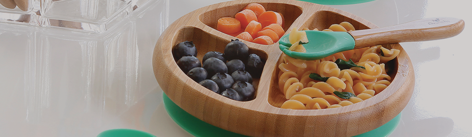 Avancy silicone bowl and spoon on table with food