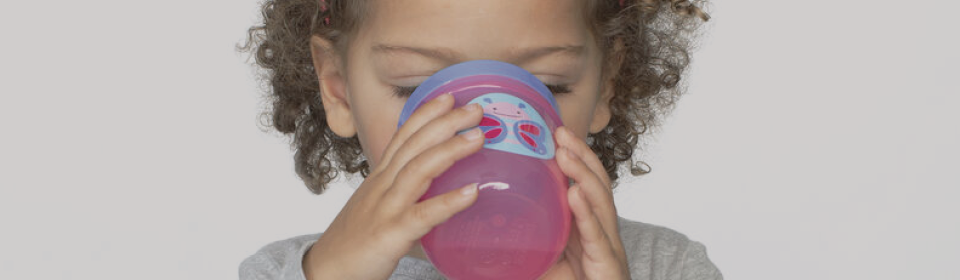 Little girl drinking water out of Skip Hop zippy cup
