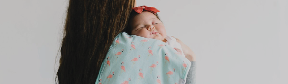 Baby laying on moms shoulder with Copper Pearl Burp Cloth