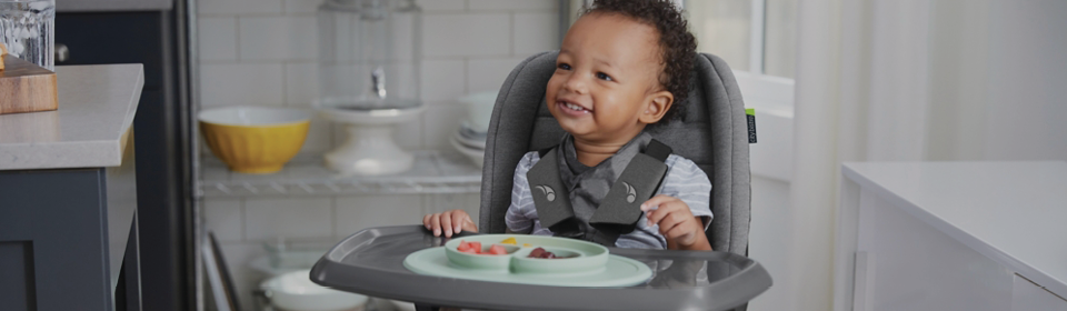 Little boy eating Baby Jogger Bistro High Chair