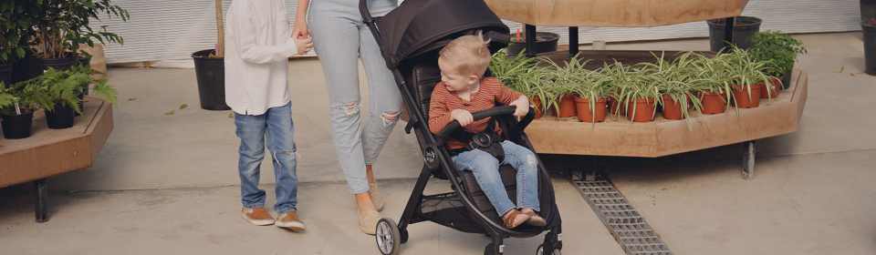 Mom pushing little boy in Baby Jogger City Tour 2 Stroller