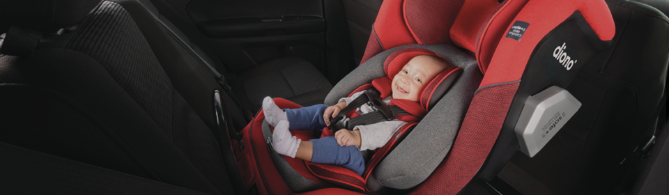 Little boy smiling in a red Diono Radian 3QXT convertible car seat