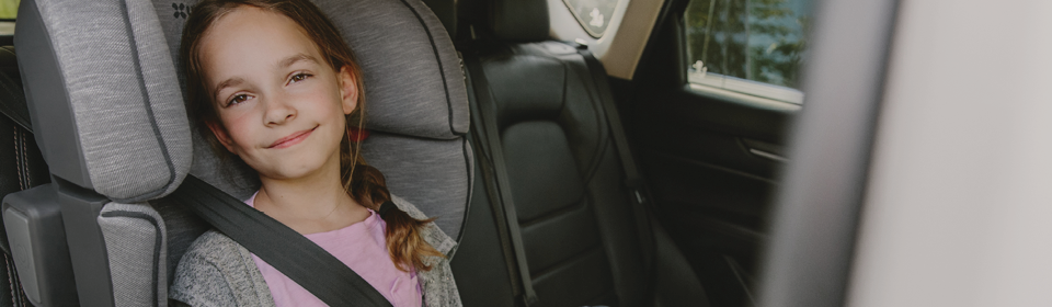 Little girl in an UPPAbaby ALTA high back booster seat