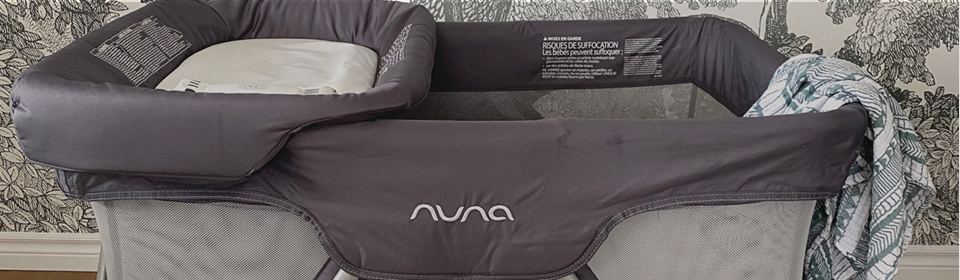 Nuna SENA Aire playard with Honest Company wipes on changer attachment