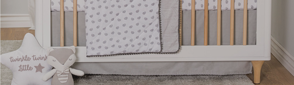 Crib with a grey Living Textiles Bed crib skirt