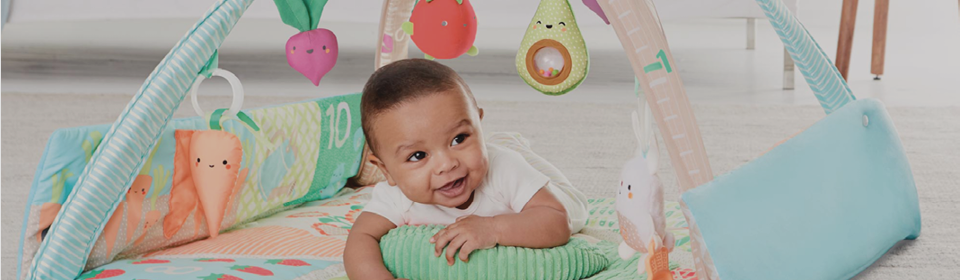 Baby having tummy time with a Skip Hop Activity Centre