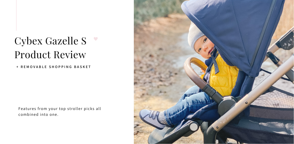 toddler looking out from the canopy of a navy blue Cybex Gazelle S stroller