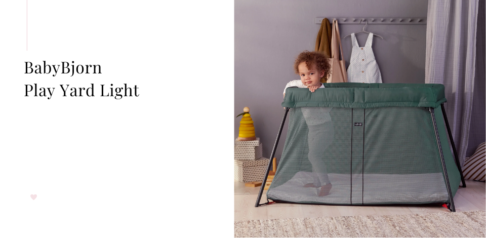 toddler standing up in the BabyBjorn playard light
