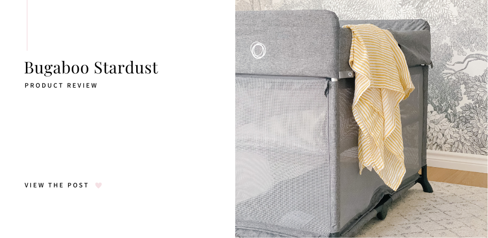 Bugaboo Stardust playard in grey melange with striped yellow Pehr muslin blanket hanging