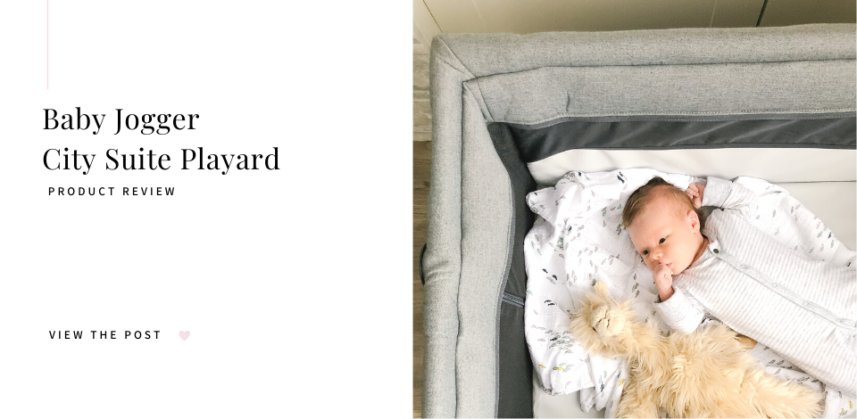 infant lounging in the Baby Jogger City Suite playard with a toy llama toy