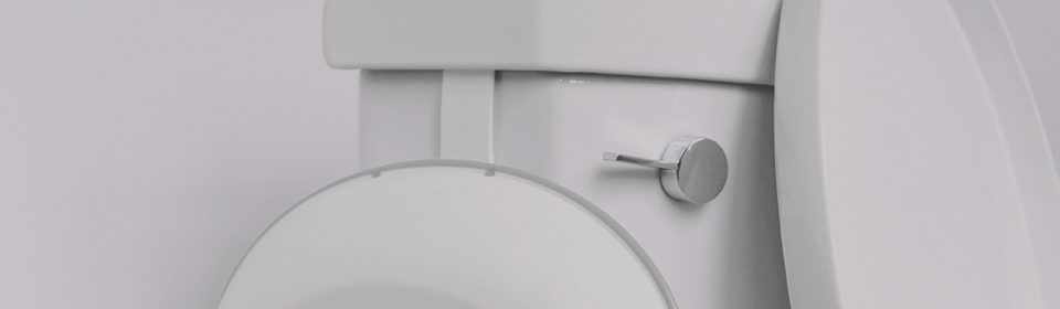 Ubbi Potty Hook hanging off side of toilet holding an Ubbi Toilet Trainer