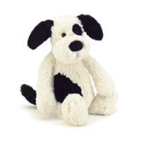 Black and white plush dog from Jellycat