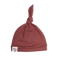 Burgundy newborn knotted hat by The Over Company