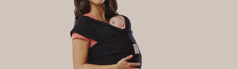 Mother wearing a Baby K'Tan baby wrap