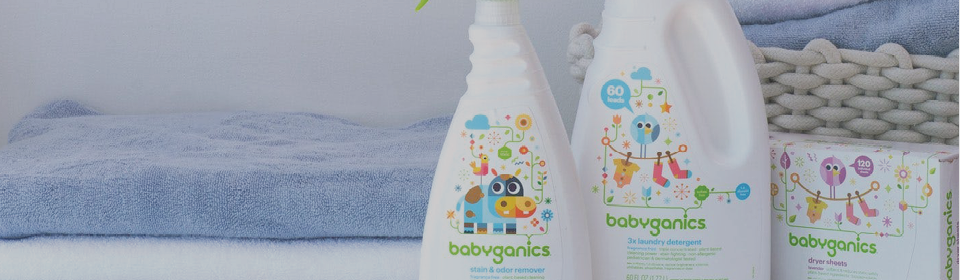 Folded towels in the background with Babyganics laundry products