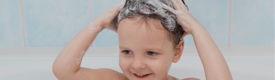 Little girl wash hair with bubble baby shampoo and wash