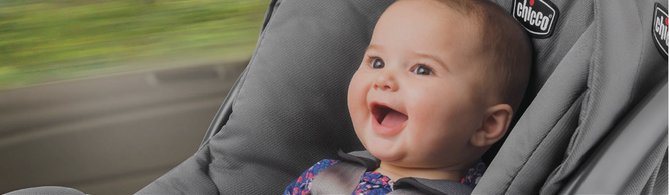 Little girl smiling in a Chicco KeyFit 30 infant car seat