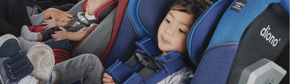 Children in Diono Radian 3RXT and 3QXT convertible car seats sitting 3 across in backseat of car