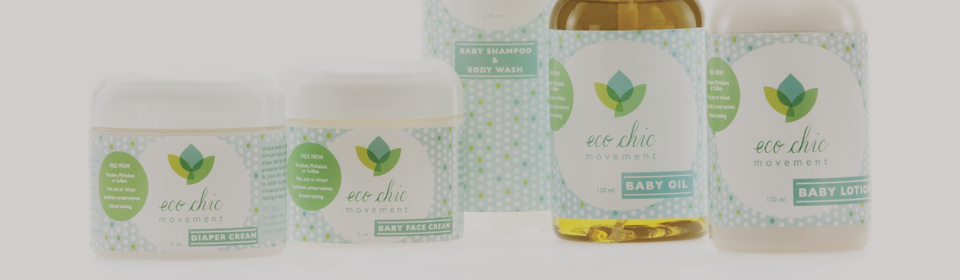 All natural Eco Chic Movement baby lotions and oils on table