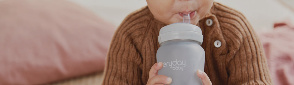 Baby drinking from EveryDay glass straw bottle