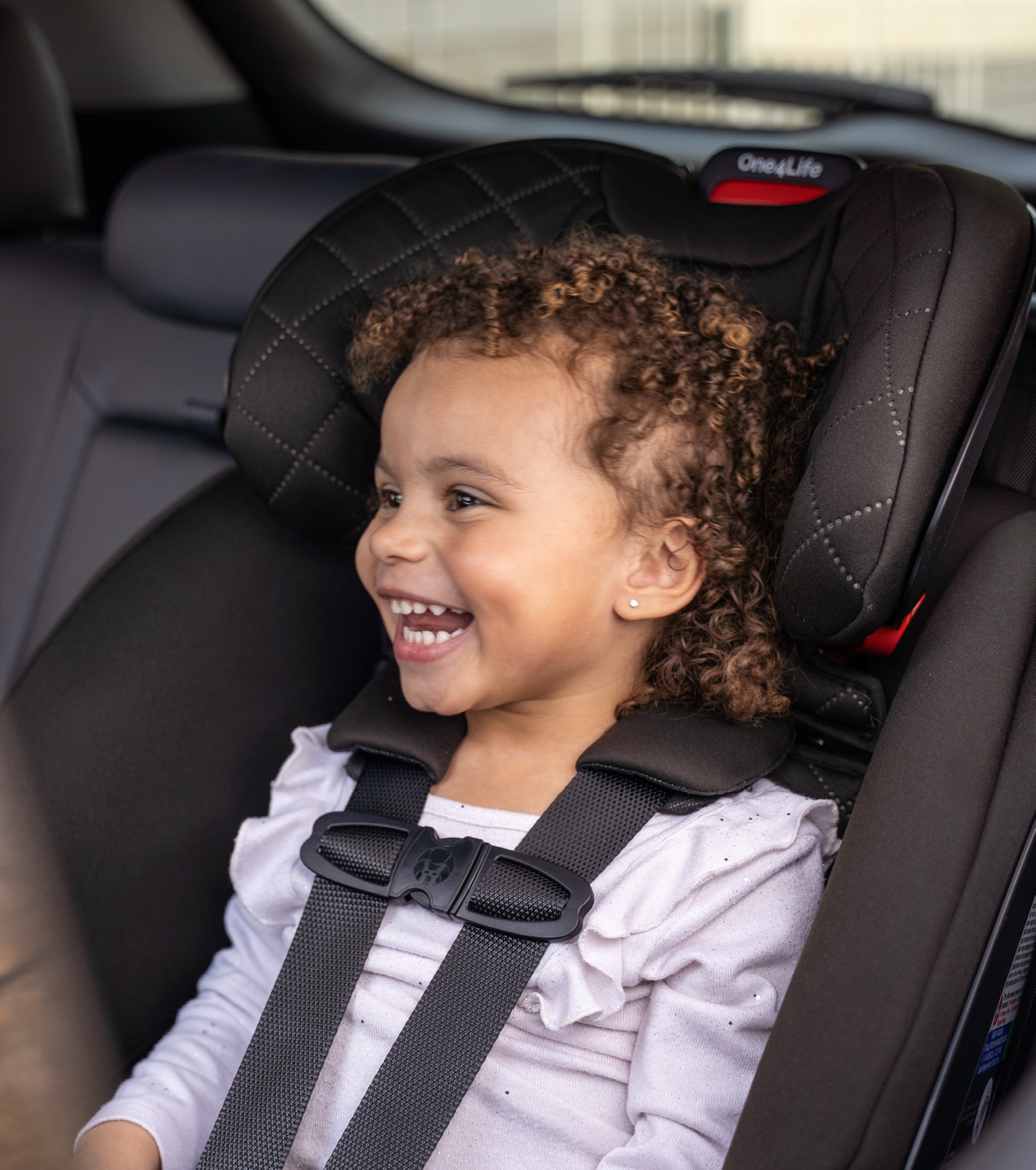 Little girl smiling in Britax One4Life ClickTight All-In-One car seat