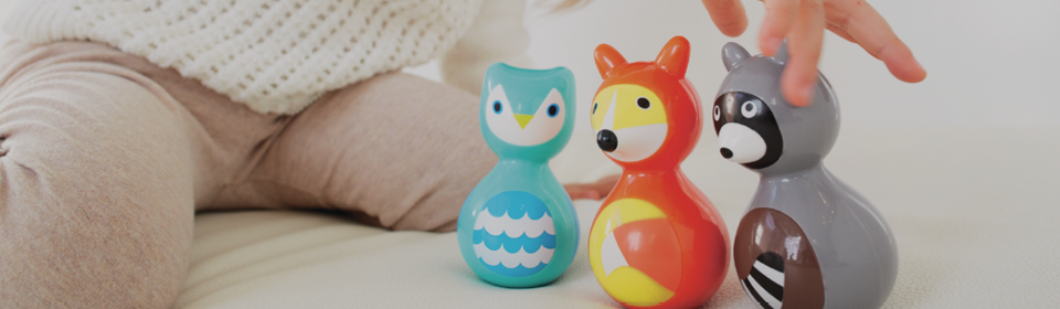 Little girl playing with KidO wobble fox, owl and racoon toys