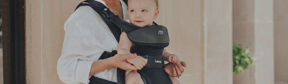 Mother carrying baby in Lascal M1 baby carrier