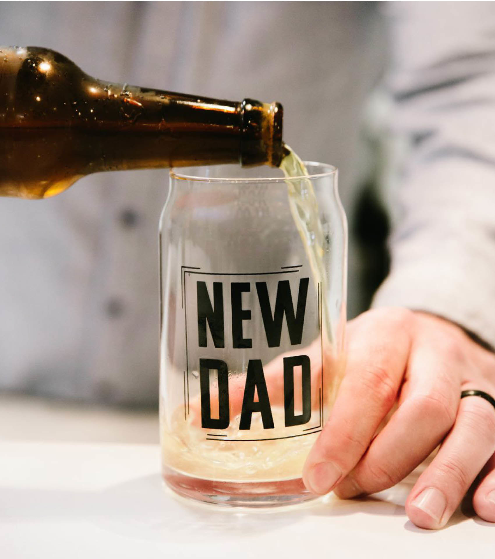 Father pouring drink into a New Dad glass mug