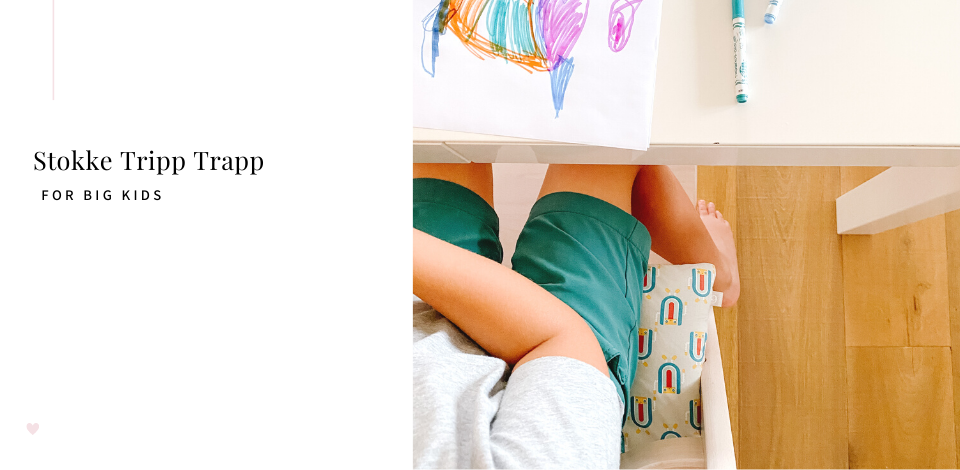 Toddler drawing while sitting in a Stokke Tripp Trapp High Chair