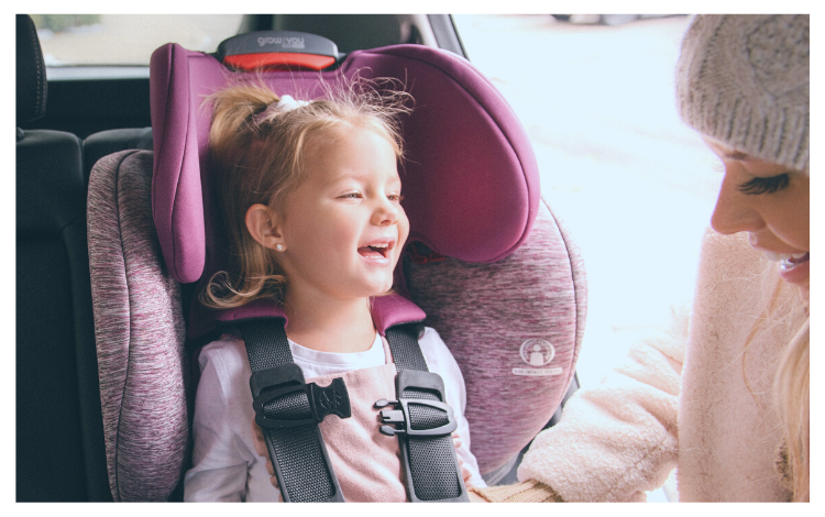 Smiling Child and Mother using Britax Grow With You Car Seat