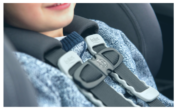 Smiling child in Britax Boulevard car seat showing harness