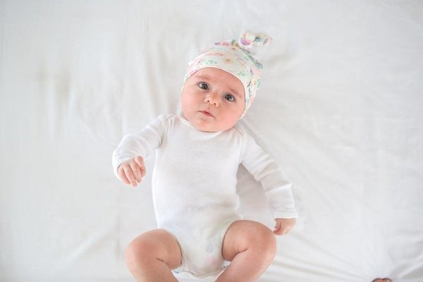 View larger image of Copper Pearl Newborn Top Knot Hat - Bloom